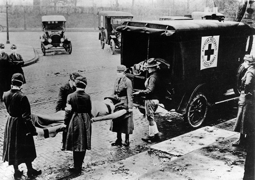 Red Cross volunteers assist a victim of the 1918 Influenza Pandemic